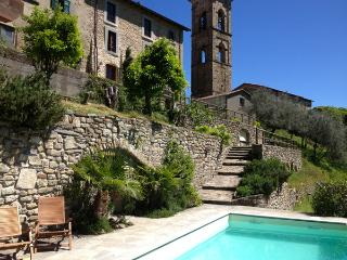 View of the villa and the campanile (bell tower) of the village church from the pool terrace