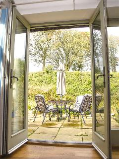 Double French doors give direct access to a sunny, totally private terrace