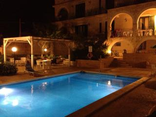 The Villa and the pool by night