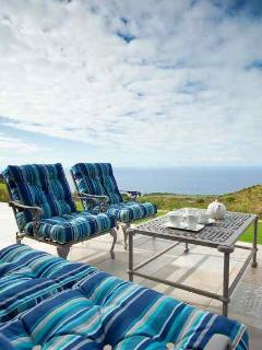 Outside patio area overlooking golf course and ocean