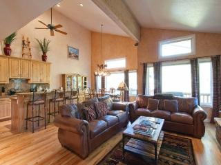 Living/Great room looking towards outside deck with barbeque. Kitchen is to left.