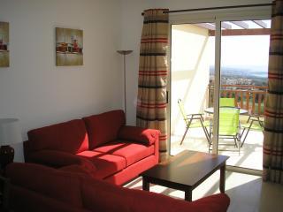 Comfortable lounge with doors to balcony
