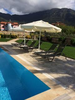 pool area sun loungers and umbrellas