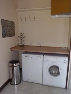 Utility area with dishwasher, washing machine and clothes drying area