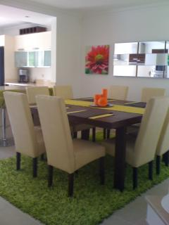 Large dinning room table has seating for 10