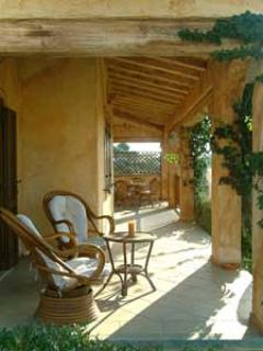 Relax on the terrace which runs the entire length of the villa