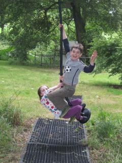 Fun in the enclosed garden with the zip wire