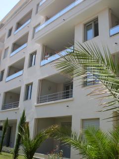 Balcony overlooks a quiet inner courtyard garden