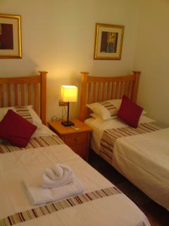 Bedroom 2: Is air-conditioned with fitted double wardrobe and a bedside table.