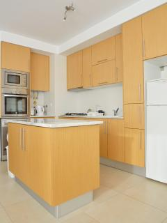 Well equipped kitchen with oven, microwave, gas hob, washing machine and  fridge freezer.