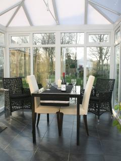 The dining room is in the conservatory - overlooking the pond, garden & the Llamas