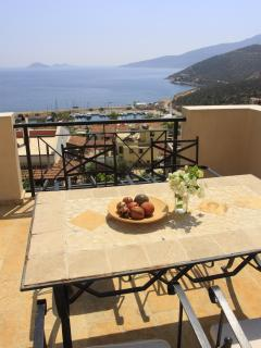 Enjoy the views from the furnished balconies at Villa Badem