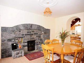 Large separate dining room with open fire