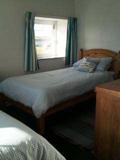 The bright and airy dual aspect twin room has two single beds.