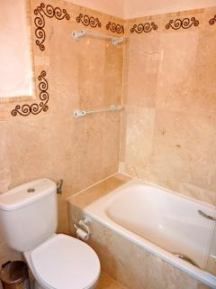 En suite to master bedroom with bath/shower