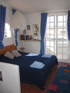 Top floor bedroom with en-suite shower and WC, balcony overlooking the water