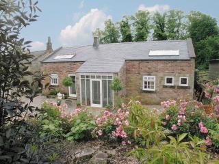 Peartree Cottage which has three bedrooms and two bathrooms