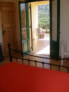 upstairs double bedroom to balcony
