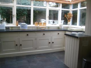 Conservatory style kitchen overlooking patio garden
