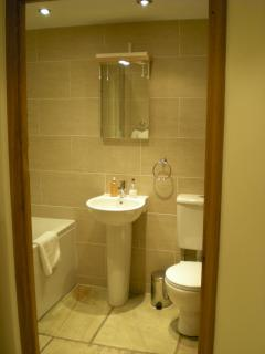 En suite to twin room with a huge over bath rain shower & underfloor heating!