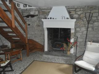 The lounge - cosy by the log-burner but cool in the height of summer