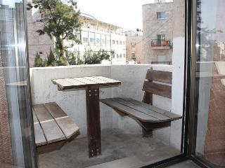 Hand-made Brazilian Ipa wood seating in private balcony
