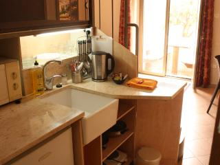 Complete kitchen with plenty of counter space; undercounter fridge