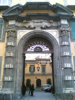 Entrance of the Palazzo Pignatelli building, we are inside in the courtyard