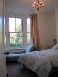 Luxurious master bedroom with view over private garden