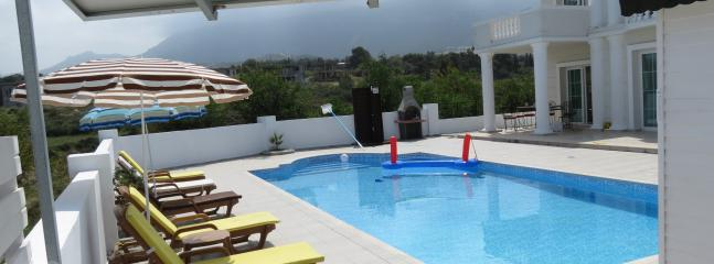Large pool with extensive terracing and 180 degree sea and mountain views
