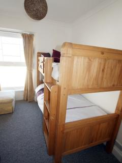 Bedroom 2 with sea view. Strong wooden bunk beds suitable for adults or children. Sleeps 2.