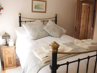 A comfy double bed at Goleby's Cottage
