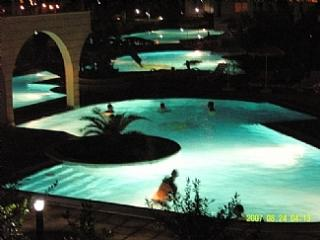 Rear pools at night viewed from rear balcony.