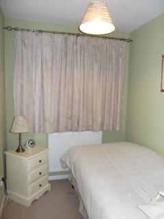 single bedroom - view to front.  Fitted cupboard
