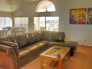 Living Area with 6 seater leather sofa.