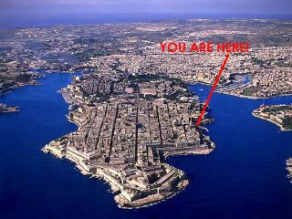 Breathtaking view of Valletta, UNESCO World Heritage City, surrounded by deep-blue waters.
