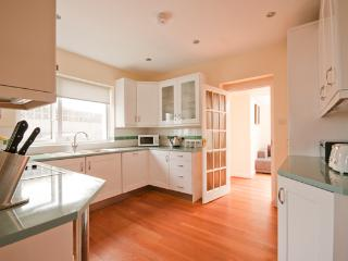 Fully fitted kitchen with access to the dining room and Family Den