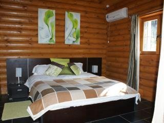 double bedroom with plenty of storage furniture and ensuite