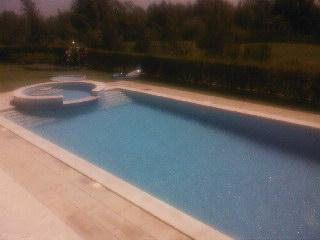 The Pool. looking from the Patio, Shallow Lounge Pool Area and Shower, Lawns