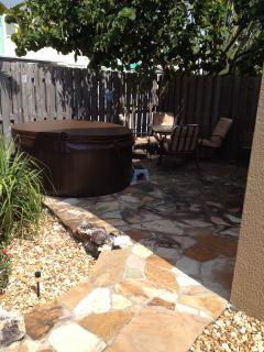 Backyard patio with hot tub, sitting area
