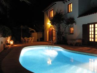 Villa and private pool at night