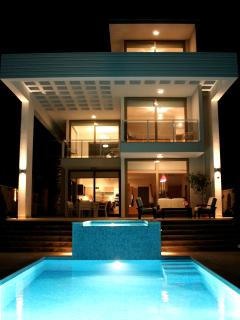 Under-water lit pool by night
