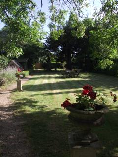 View of garden with seating area and wendy house