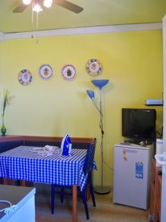 Bright yellow kitchen with TV/DVD and microwave
