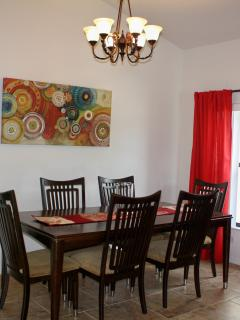 Dining Room table with plenty of seating for dinner