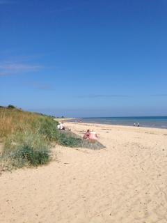 Alnmouth beach under a clear blue sky