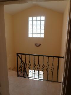 villa's marble interior, wrought iron staircase