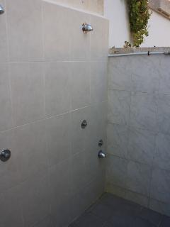 Shared outdoor shower, which is perfect to take away the sand and salt before entering the apartm