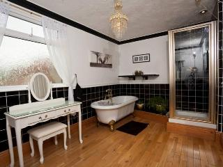 Large familly bathroom, free standing bath, walk in shower, wood floor with period features