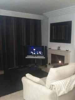 Living room with Bang and Olufsen TV sky and DVD